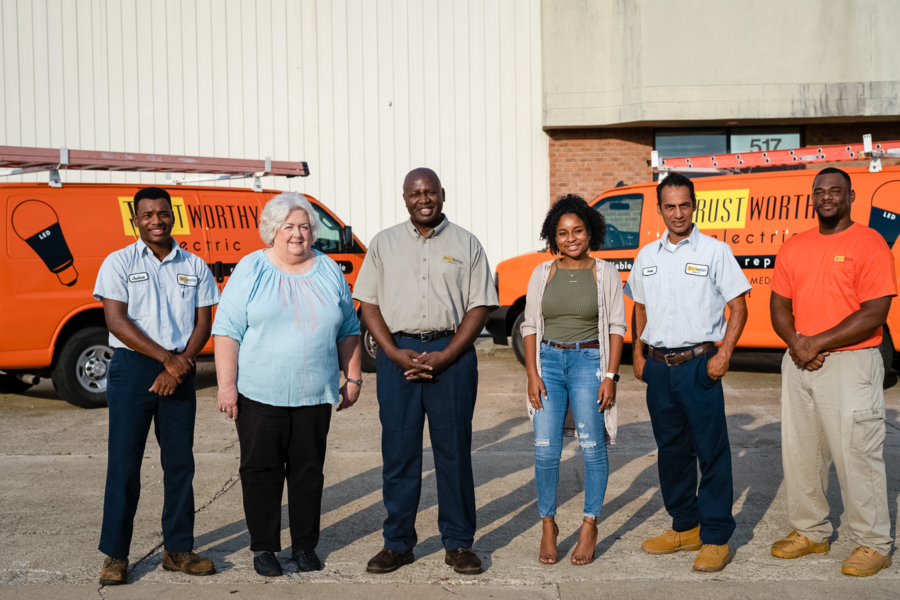 Trustworthy Electric team standing in front of company vans